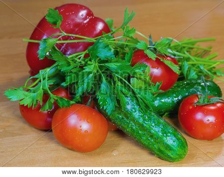 The tomatoes cucumbers bell peppers and greens