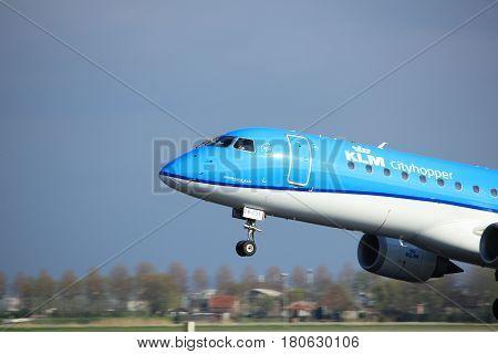 Amsterdam the Netherlands - April 7th 2017: PH-EZB KLM Cityhopper Embraer ERJ-190STD takeoff from Polderbaan runway Amsterdam Airport Schiphol