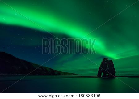 Aurora borealis above Hvitserkur rock formation Iceland