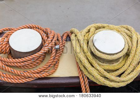picture of bollards with mooring ropes at a harbor