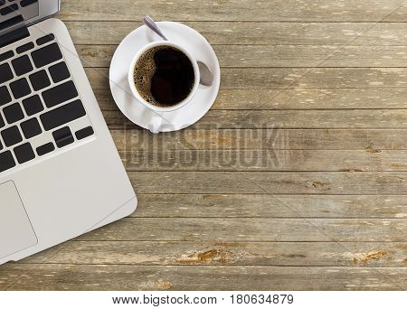 High angle view of office desk with copy space. Table with laptop and cup of coffee. Flat lay. Freelancer or student desk. Top view with copy space for design