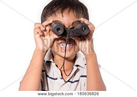 Cute asian little boy with binoculars on white backgroud