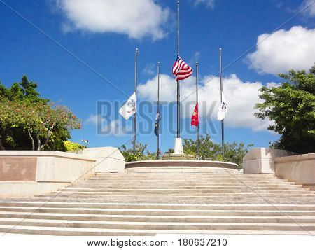 Court of Honor, American Memorial Park, Saipan The US flag and US military flags at half staff at the Court of Honor, American Memorial Park in Garapan, Saipan.