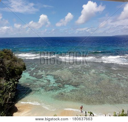 Ladder Beach, Saipan, CNMI topview Top view of Ladder Beach showing its crystal clear waters and the reefs