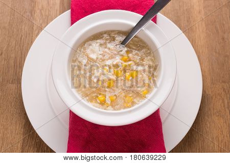 chicken sweetcorn soup in a bowl with a spoon