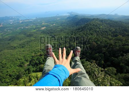 successful hiker enjoy the view hiking on mountain peak