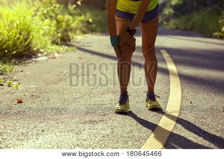 young fitness woman runner got sports injury on knee
