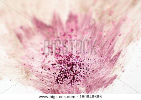 Modern art, creative abstractionism, bright color explosion. Abstract brush painting of blurred purple flower with glitter on white background.