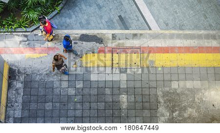 Aerial view and top view with People are walking in Business area with pedestrian and red and yellow block walkway