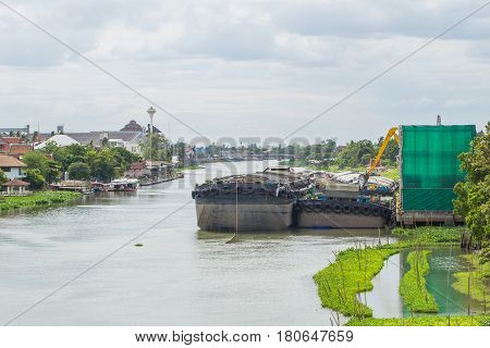 River in Thailand with Boat Big barge carry sand.