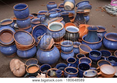 Traditional Ceramic Jugs.Handmade Ukraine Ceramic Pottery in a Roadside Market with Ceramic Pots and Clay Plates Outdoors.
