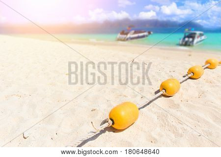Summer Sea beach with yellow buoys Safety Swimming zone separator Thailand ocean travel background.