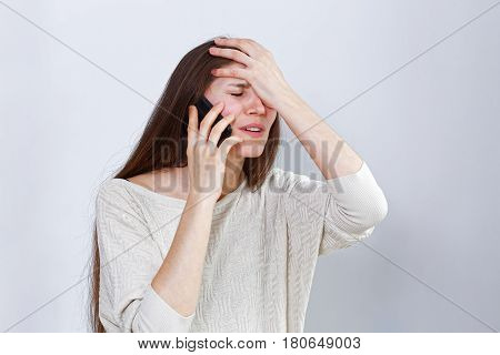 Portrait Of A Distressed Young Woman Talking On The Phone