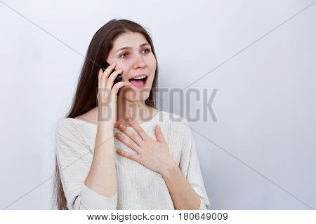 Portrait Of A Happy Young Woman Talking On The Phone