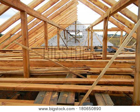 Attic Construction. Wooden Roof Frame House Construction. Roofing Construction.