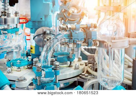 Chemical and laboratory equipment, chemical reactor. Abstract industrial background, sunshine