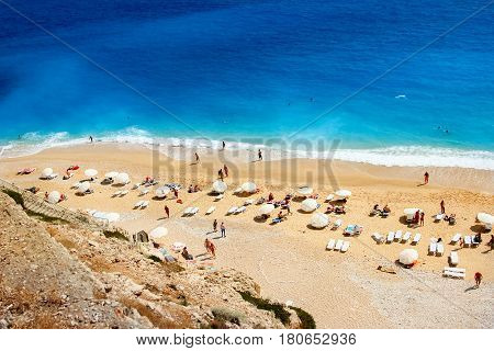 Turkey, the Mediterranean Sea, Kaputash Beach - June 2016: people rest on the beach on the Mediterranean coast.