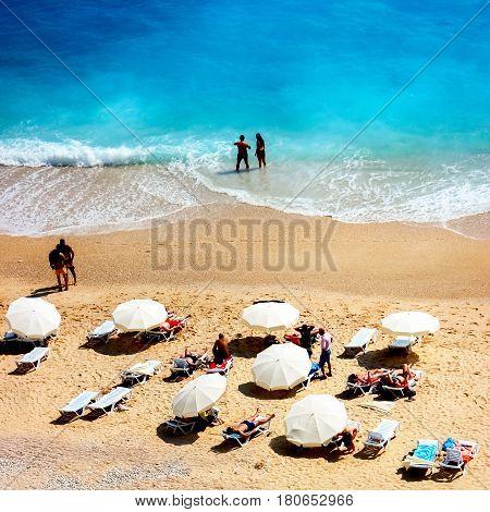 Turkey, the Mediterranean Sea, Kaputash Beach - June 2016: people rest on the beach on the Mediterranean coast.