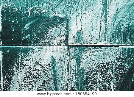 paint of white and blue colors on the stone texture background.