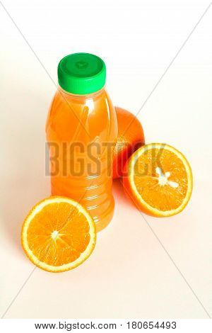 Bottle Of Orange Juice And Oranges