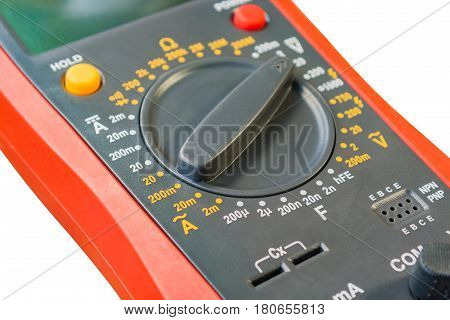 Fragment of digital multimeter closeup isolated on white background