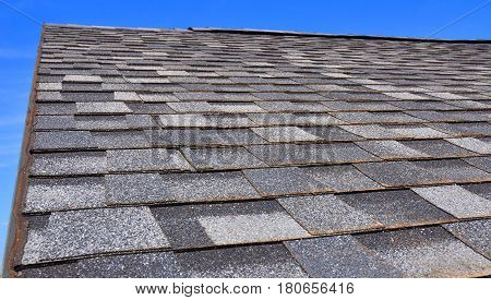 Newly Installed Roof with Textured Asphalt Shingles or Bitumen Tiles on the Rooftop Outdoor. Asphalt Tiles.
