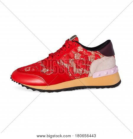 red female sneaker isolated on white background