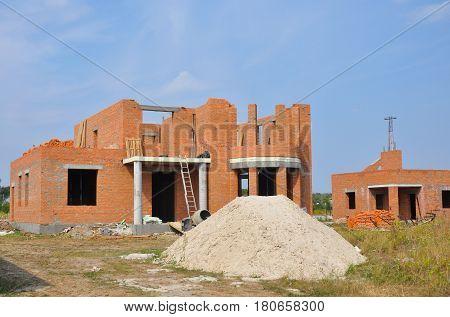 New brick building house construction with doorway columns windows balcony