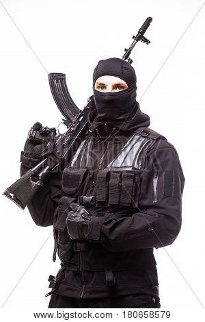 Portrait Of Dangerous Bandit In Black Wearing Balaclava And Holding Gun In Hand