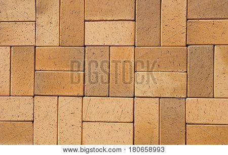 Beautiful Luxury German Vintage Yellow Brown Ceramic Clinker Pavers for Patio as a Textured Background for Your Text. Add Your Text. Floor pavers in a path detail of a pavement to walk.