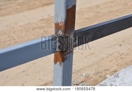 Close up Weld on a Steel Iron Bar for a New Fence Frame. Welding is a Fabrication or Sculptural Process That Joins Materials Usually Metals or Thermoplastics by Causing Fusion.