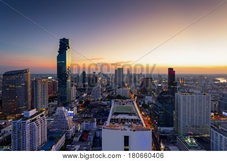 Aerial view of Bangkok modern office buildings condominium living place in Bangkok city downtown with sunset scenery Bangkok is the most populated city in Southeast Asia.Bangkok Thailand