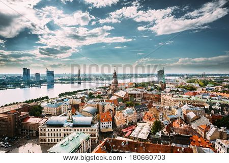 Riga, Latvia - July 1, 2016: Riga Cityscape In Sunny Summer Day. Famous Landmarks - Town Hall, Riga Dome Cathedral And St. James's Cathedral, or the Cathedral Basilica of St. James