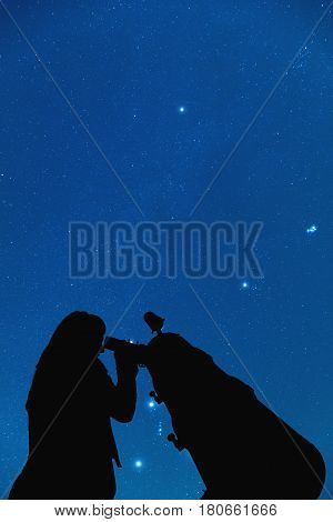 Girl looking at the stars through a telescope. 3D render / illustration.