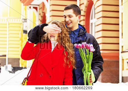 Romantic Date. Man Closed Eyes Of His Girfriend To Make A Surprise. Beautiful Young Couple Walking T