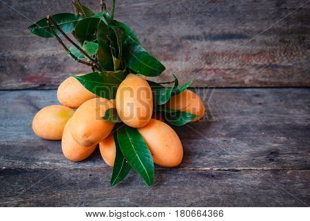 Fresh Marian Plum On Wood Background.
