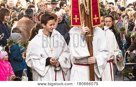 Neuoetting,Germany-April 9,2017:Altar boys walk at the head ot the Palm Sunday Procession