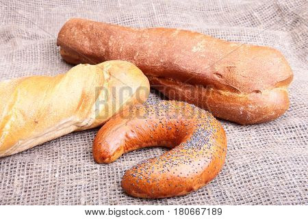 Assorted fresh breads isolated on old sackcloth