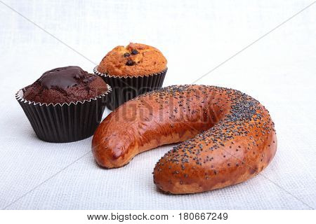 Assorted fresh breads, muffin and cake isolated on a white background