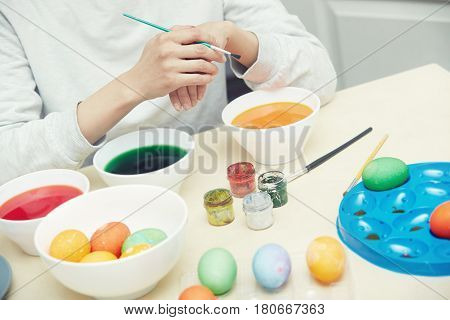 Hands of woman preparing and dying Easter eggs