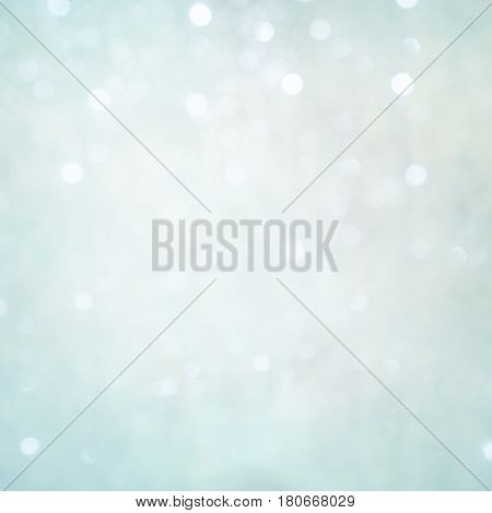 Delicate backdrop for design. Beautiful light Blue Holiday Texture with Bokeh lights. Winter Christmas backdrop with tinted edges. Square Wallpaper Web Banner With Copy Space