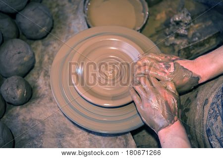 Craftsman Artist Making Craft, Pottery, Sculptor From Fresh Wet Clay On Pottery Wheel