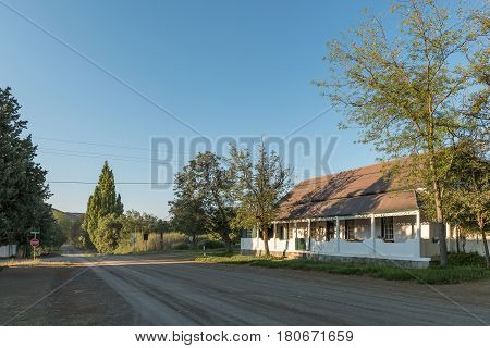 NIEU BETHESDA SOUTH AFRICA - MARCH 22 2017: An early morning street scene with the old parsonage of the Dutch Reformed Church in Nieu-Bethesda an historic village in the Eastern Cape Province