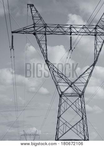 BLACK AND WHITE PHOTO OF TRANSMISSION TOWER OR ELECTRICITY PYLON
