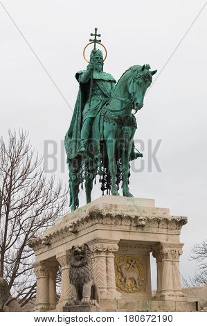 King Saint Stephen statue located near the Matthias Church and Fisherman's bastion in Buda castle on a cloudy day, Budapest, Hungary