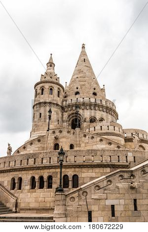 Tower of the Fisherman's bastion in Buda castle on a cloudy day, Budapest, Hungary
