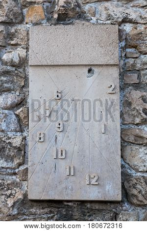 Sundial on the stone wall of royal palace in Budapest, Hungary