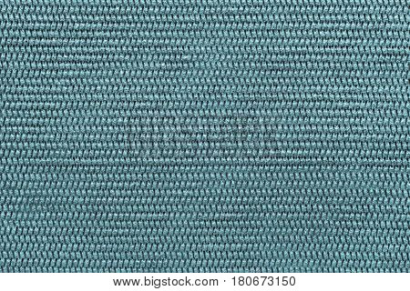 the abstract textured background of pale blue color of polymeric material or synthetic fabric with a corrugated symmetric pattern and with small droplets of water