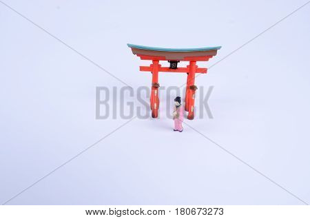 The Japnaese Figure With Shinto Gate