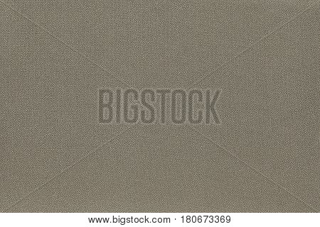 abstract speckled texture and background of textile material or fabric of pale khaki color